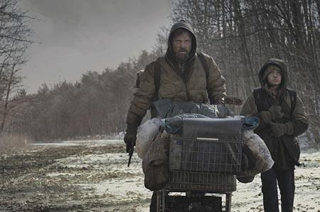"""Mortensen as """"The Man"""", surviving with his son, """"The Boy""""."""