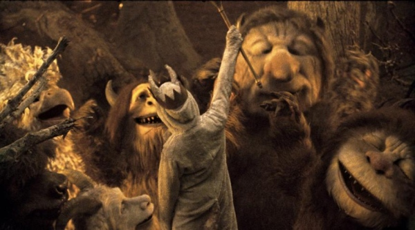 "Boy king, Max, commands wild creatures in ""Where the Wild Things Are""."